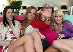 Girls are making a sexy foursome with each other on the sofa