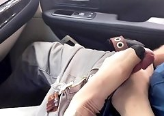 Nadia Styles uses her sexy feet to make a lover's dick hard in a car