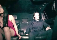 A couple is in the limo, having a great time together in the dark