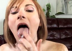 Freckled redhead takes a black dong in her mouth and pussy in POV
