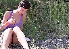 Nicoletta H in the nature touching her hot body on the grass