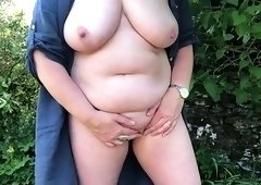 Voluptuous mature lady fucks herself with a sex toy outside