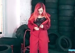 Red haired hooker Dolly shows striptease in the tire shop