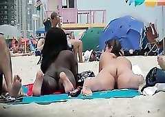 Black and white chicks naked on the beach