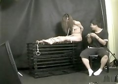 Asian brunette gets teased and stimulated during bondage