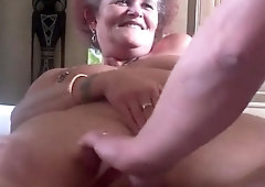 Horny amateur granny gets her juicy holes toyed and devoured
