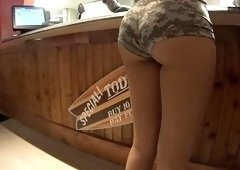 Sultry brunette waitress with a magnificent ass and hot legs