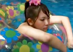 This pretty japanese  is having sex under the water