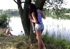 Lovely dolls make lesbian love in their secret place in the park