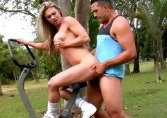 A bimbo with large tits is in the park where she is getting fucked