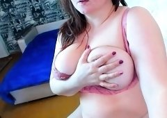 Voluptuous amateur babe shows off her big natural hooters