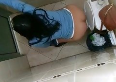 Nice ass brunette spied in public toilet