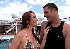 Seductive redhead Cindy Dollar sucks and rides cock on a yacht