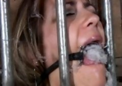 Gagged and tied up slave is being pleasured with fake penis