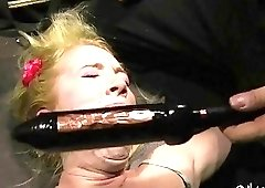 Alluring blonde screams loud in a really stimulating BDSM scene