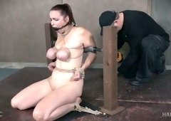 Redhead busty babe is bound and gagged to be caned nude