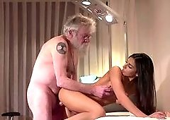 Aroused girl sucks and fucks with a very old guy