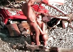 Busty girl blows and rims her BF on the beach