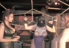 Two sluts spanking masked busty whore
