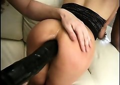 Jayna Oso gets a cock in her cunt and a huge dildo in her asshole