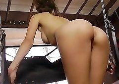 Long-legged babe on high heels is playing with her cunt