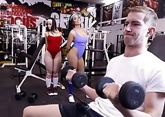 Booby brunettes get fucked by huge cock in the gym