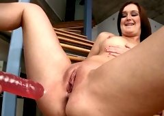 Three adorable lesbians are turning each other on with a dildo