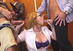 Threesome in an elevator with this big tits secretary