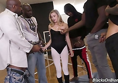 White chick Carolina Sweets is fucked by several black well endowed guys
