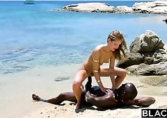 Strenuous ebony stud penetrates blondie tourist on the beach